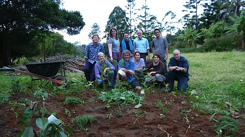 "The class and Tom, posing behind a fruit tree we planted and surrounded with about 30 ""support"" species."